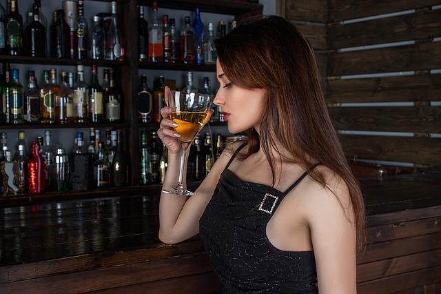 girl drinking in a bar