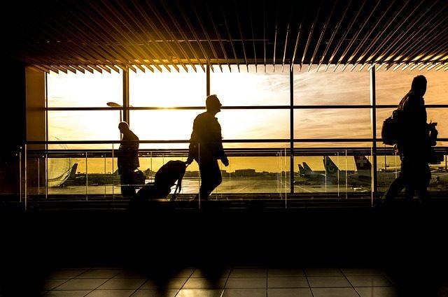 man walking through the airport