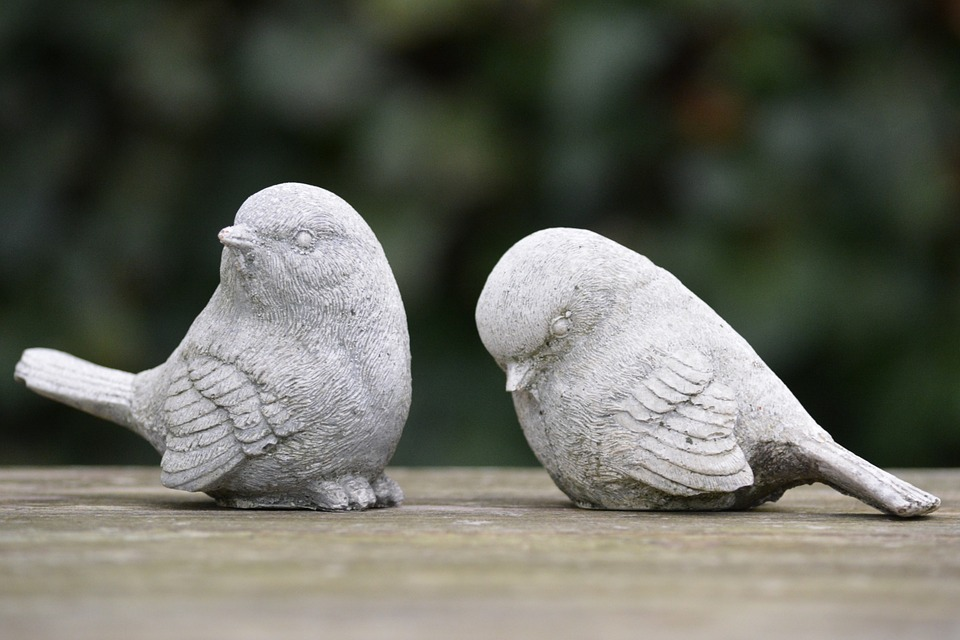 one ceramic bird rejecting another