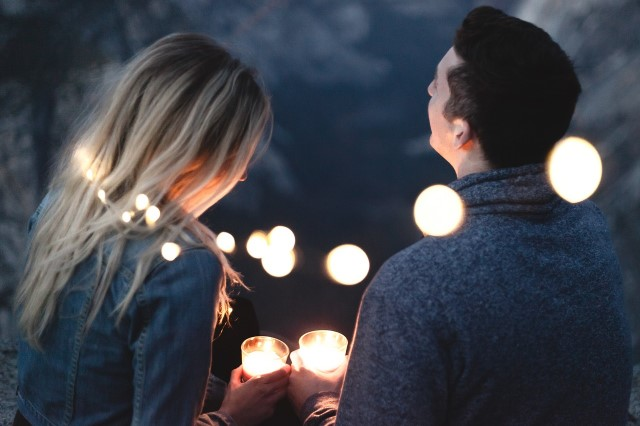 Couple holding candles on a date
