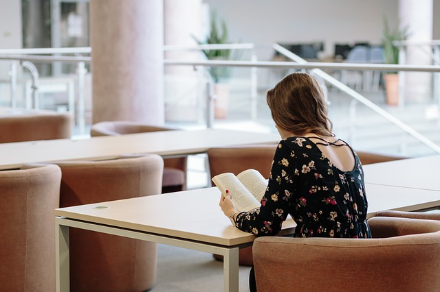 girl sitting alone in a library