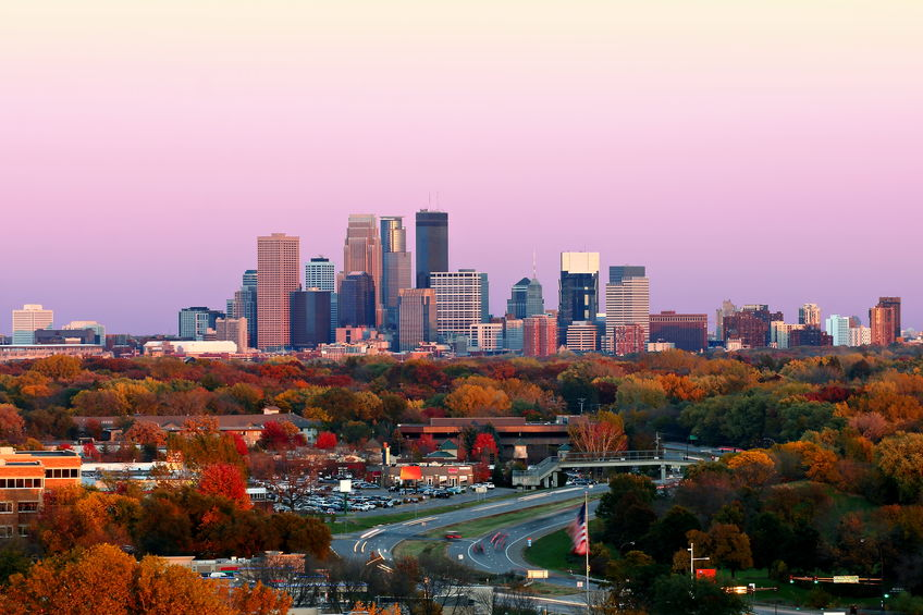 minneapolis skyline during autumn at sunset from plymouth, minnesota