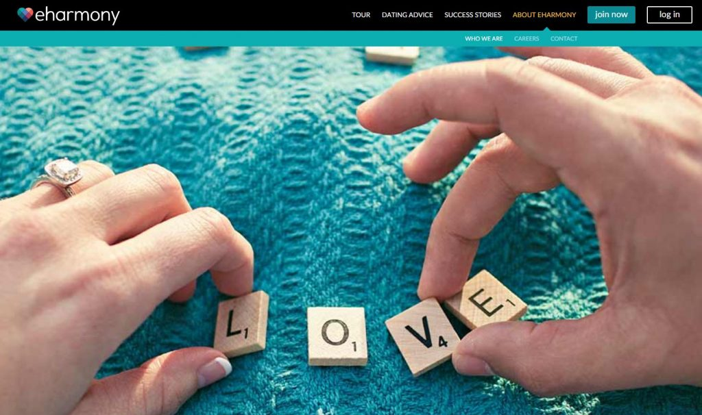 Screenshot of two hands spelling out the word love with Scrabble pieces on the eHarmony homepage