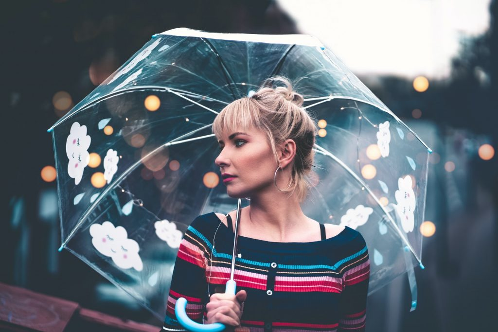 Pretty Girl with an umbrella in a striped shirt